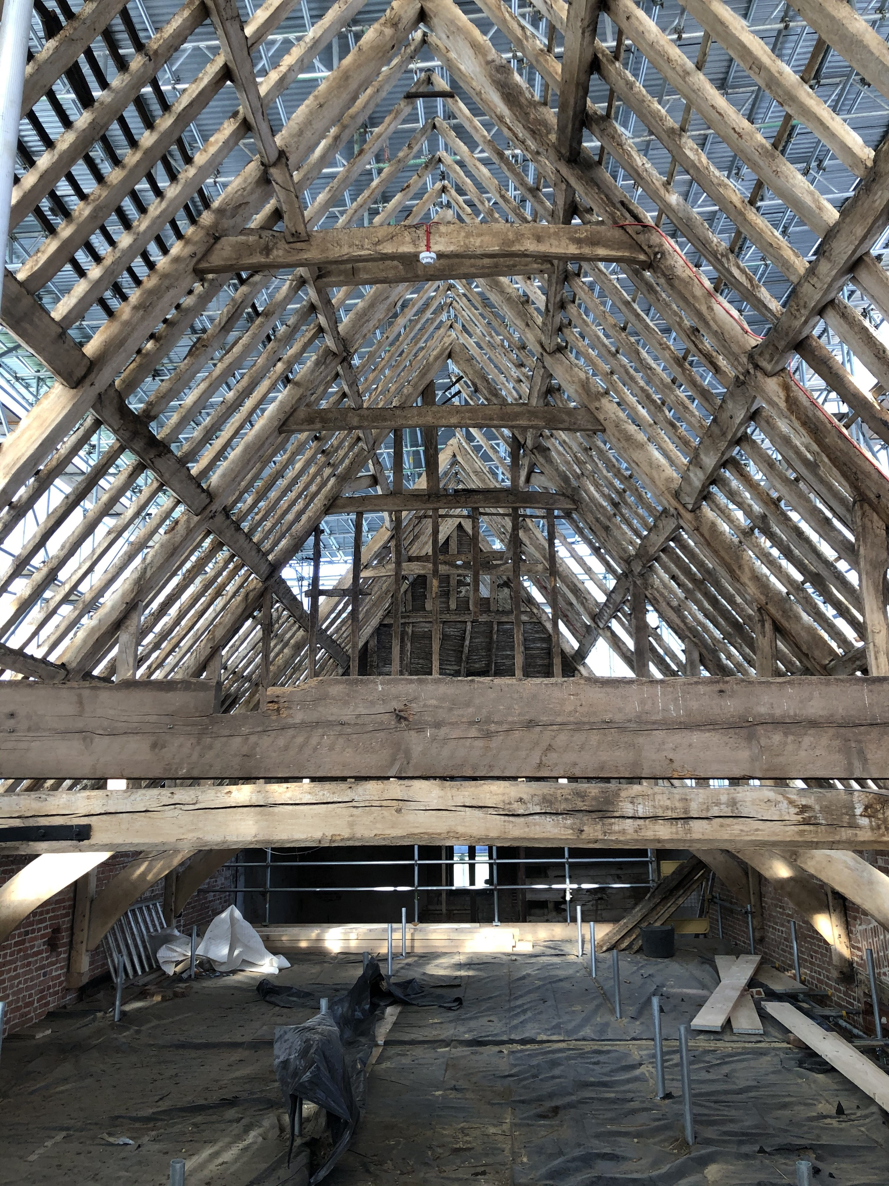 James Powell's image of a wedding ceremony in the middle of the great barn